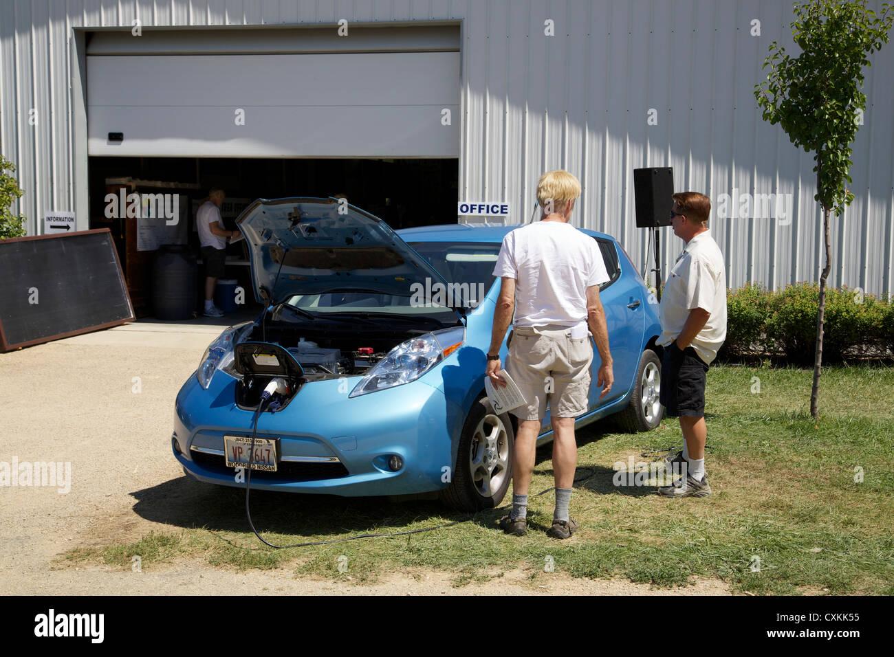 Nissan Leaf recharging. Renewable energy fair, Oregon, Illinois - Stock Image
