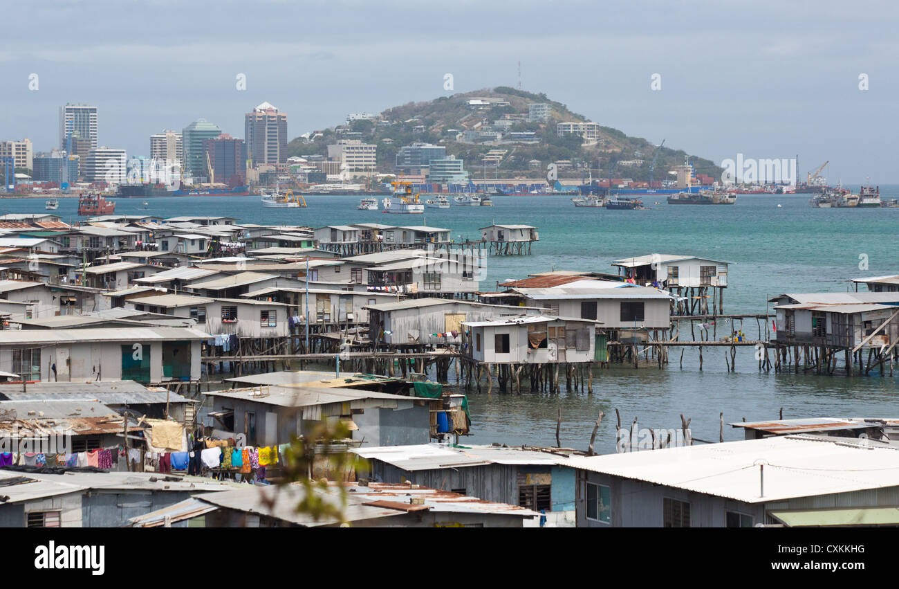 View of the water village, Hanoabada, with Port Moresby in the background, Papua New Guinea - Stock Image