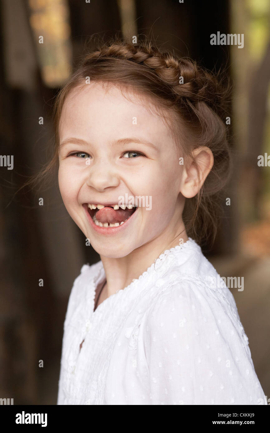 girl with missing teeth - Stock Image
