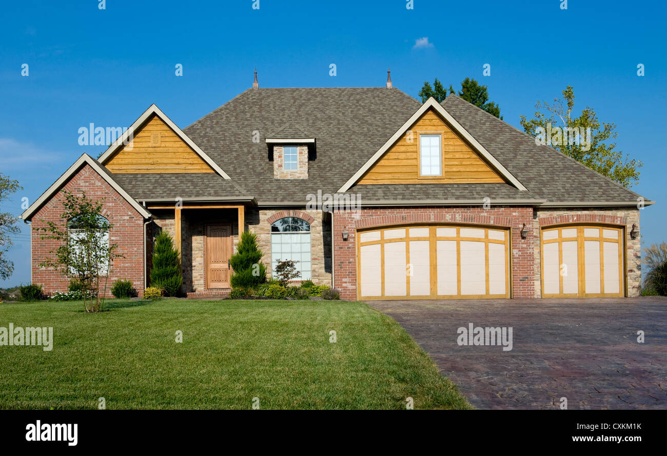 A beautiful home or house on a sunny day, construction industry, real estate or architecture concept - Stock Image