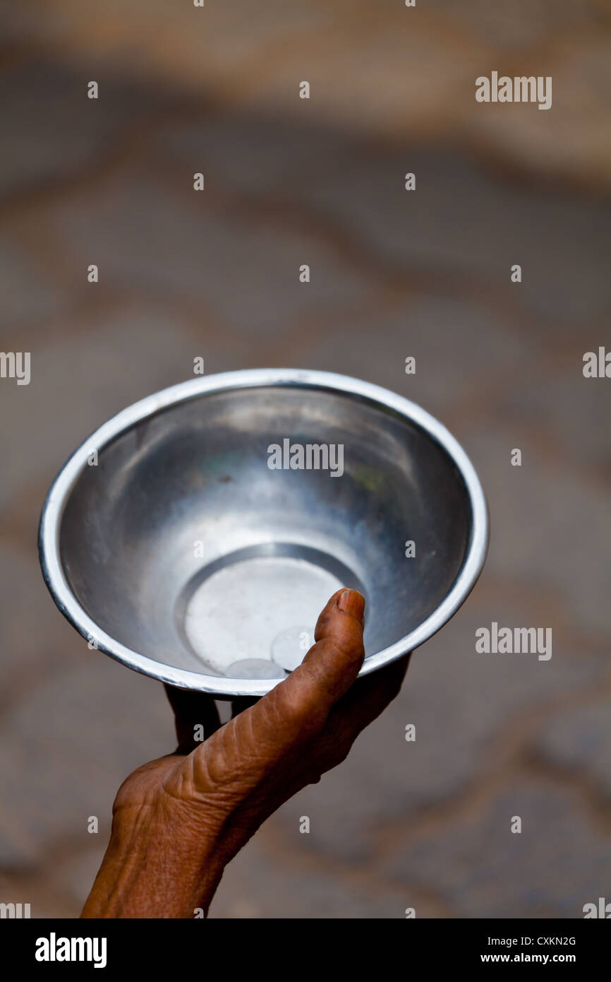 Begging Bowl in the Streets of Kolkata - Stock Image