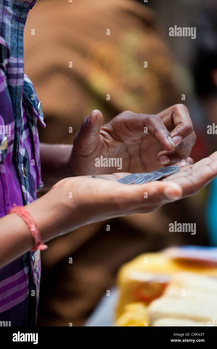 Counting Money in Kolkata - Stock Image