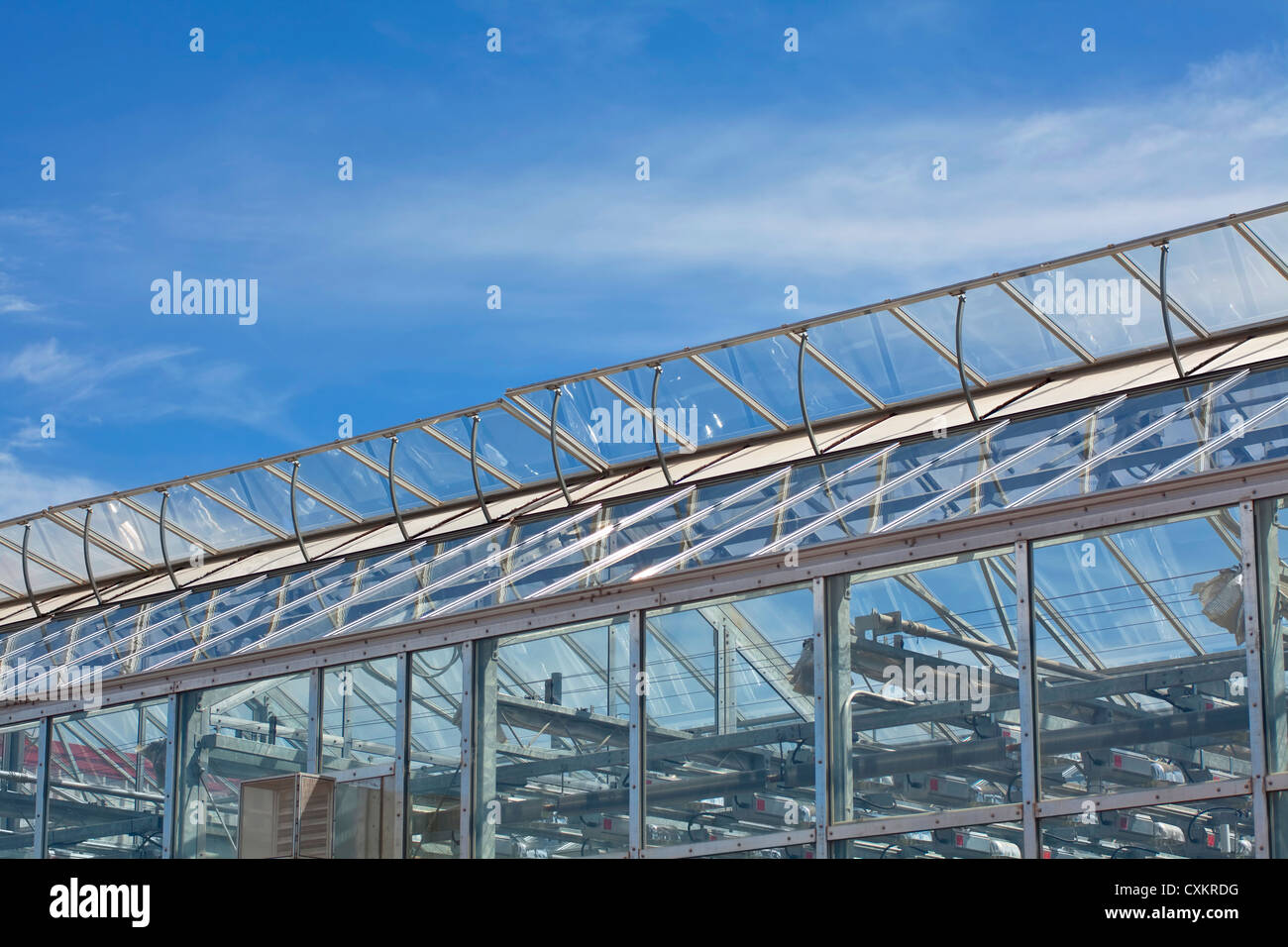 Vents on a large commercial glass greenhouse. - Stock Image