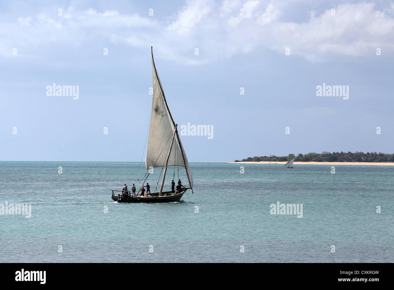 Arab sailing boat (dhow) off the Zanzibar Tanzanian coast - Stock Image