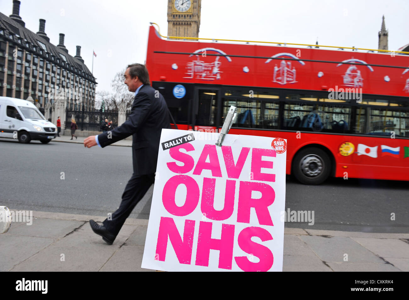 Save our NHS banner outside the houses of Parliament, Big Ben, London UK - Stock Image