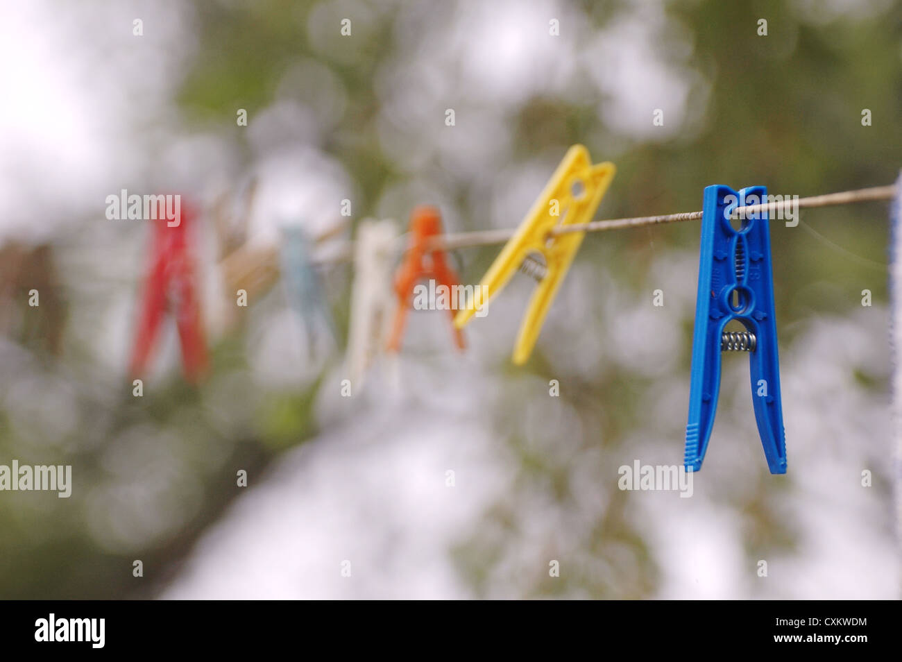 several color clothespin on clothesline - Stock Image