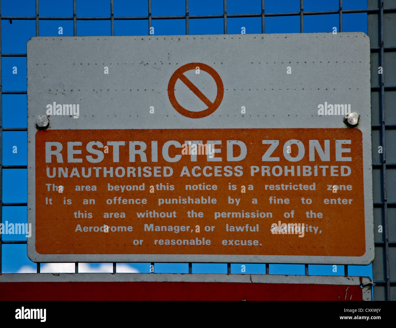 Restricted Zone sign on perimeter fence at Gatwick Airport, Crawley, Sussex, England - Stock Image