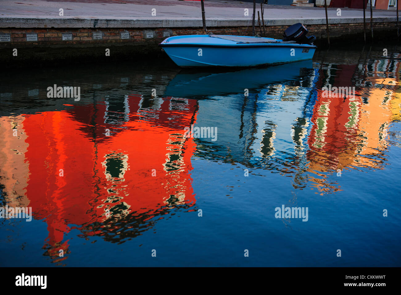 Colorful Houses and reflections in Burano, Venice, Italy - Stock Image