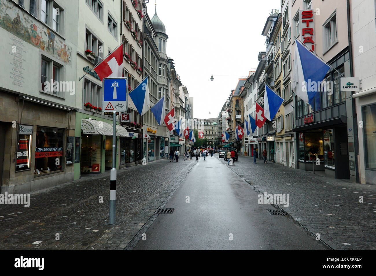 58c310cc27889 Walking in a shopping area in Zurich on a holiday. The streets were  deserted but