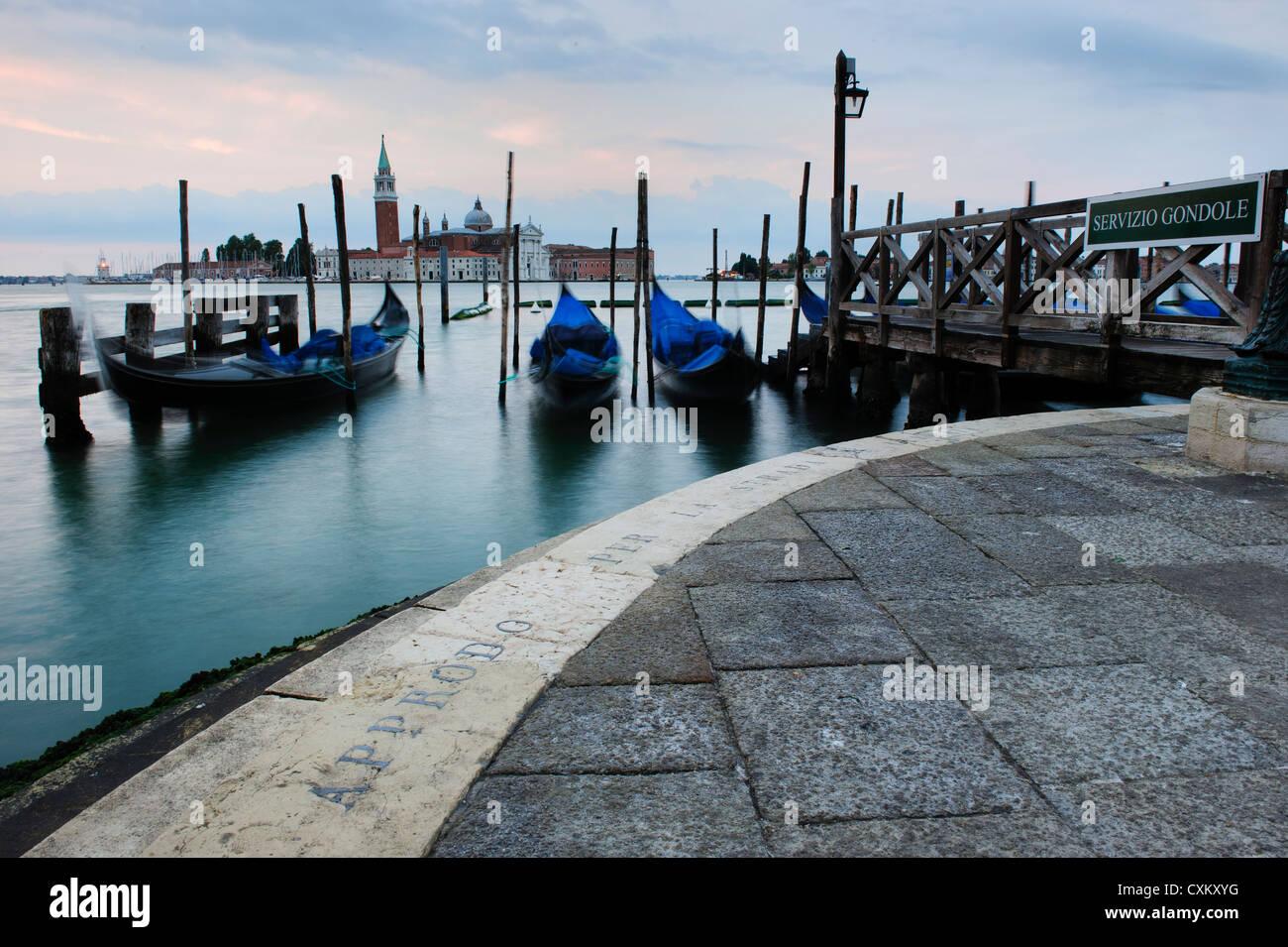 Gondolas Moored by the St. Mark's Basin, Venice, Italy. Stock Photo