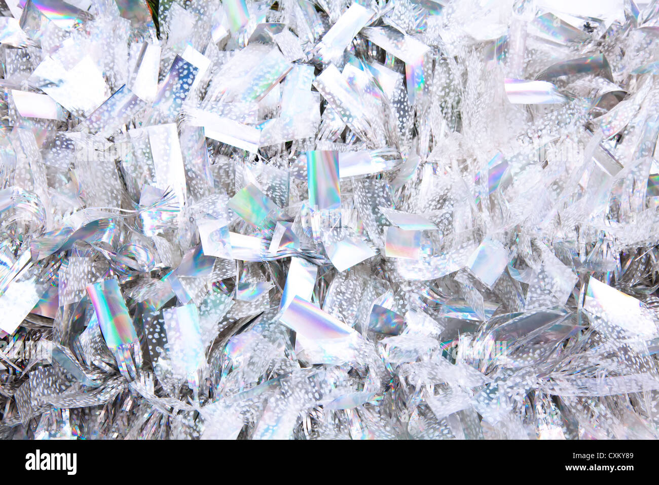 Silver sparkling christmas tinsel background - Stock Image
