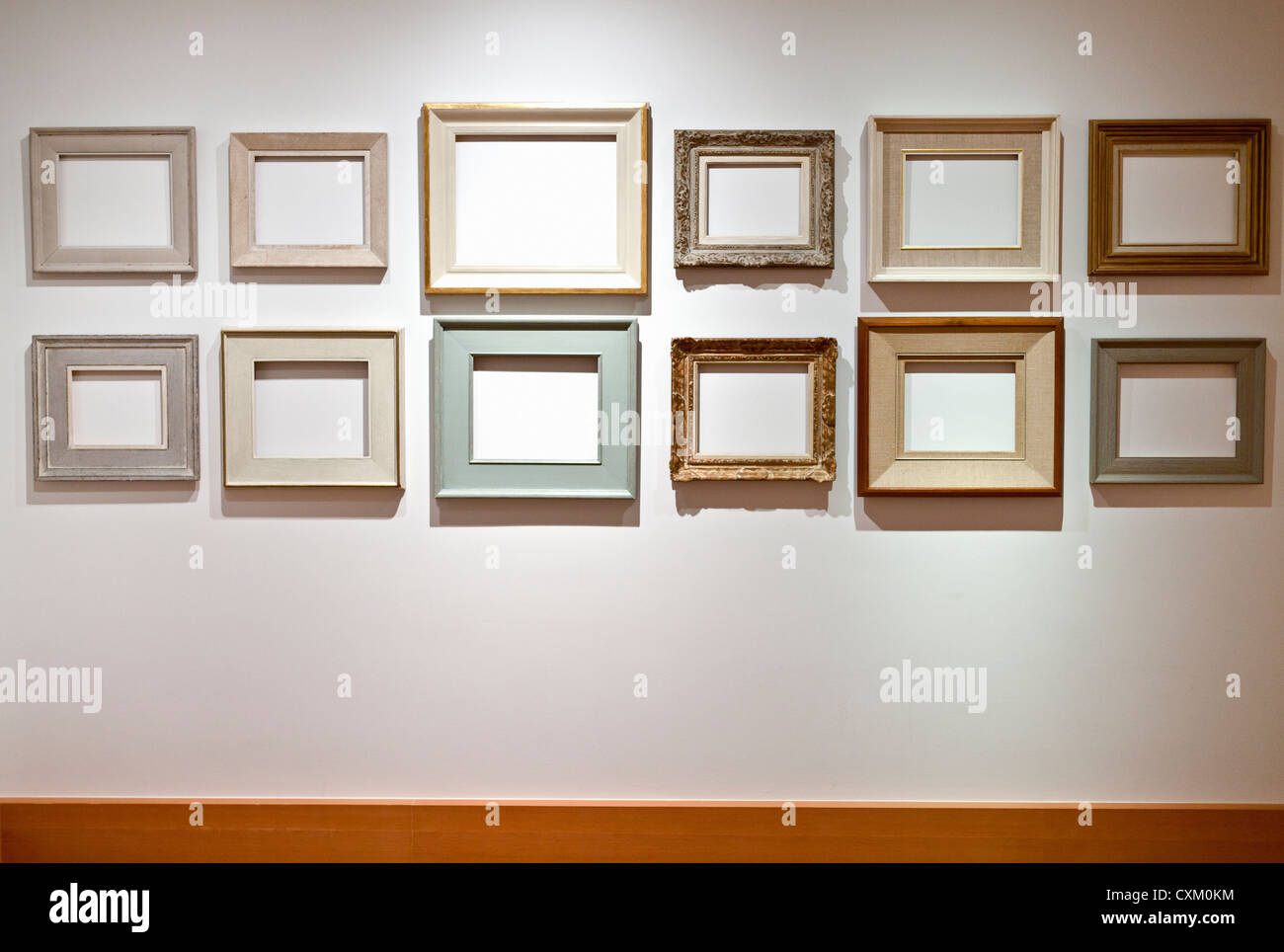 empty picture frames arranged on a white wall Stock Photo: 50841384 ...
