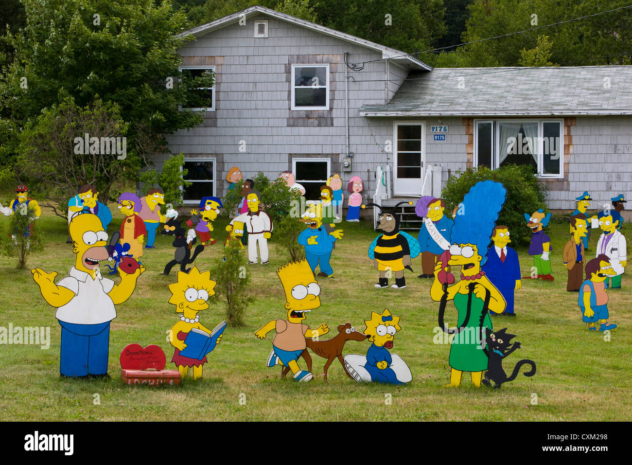 The Simpsons family, cartoon character cutouts in a garden - Stock Image