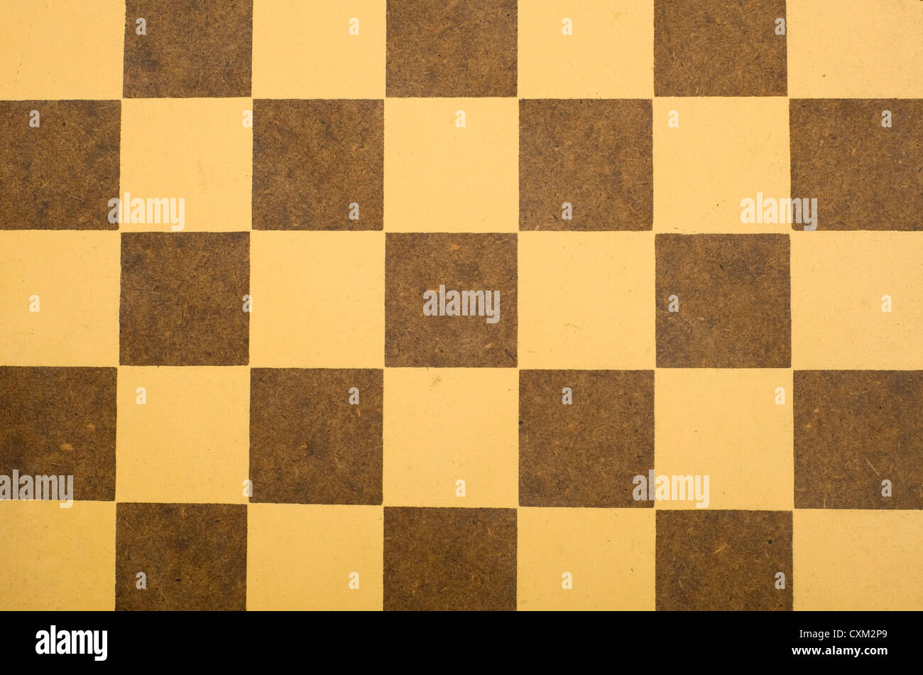 A brown and yellow antique checkerboard background - Stock Image