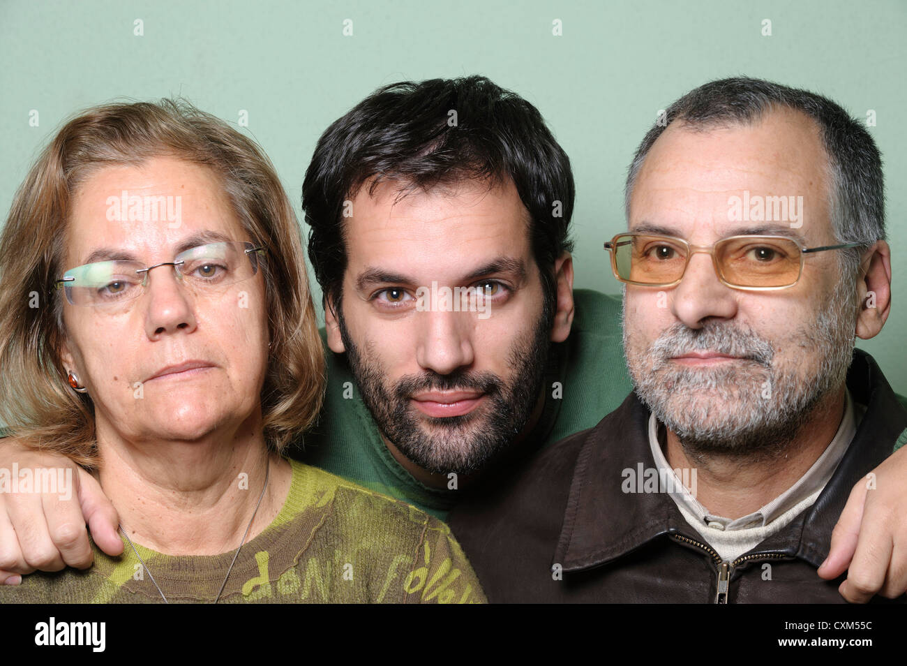 Family portrait with middle aged parents and son - Stock Image