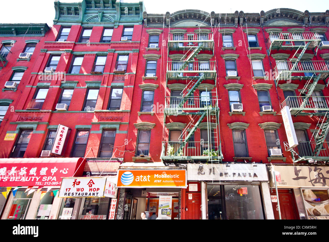 New York City - Aug 29:  Historic tenement apartment buildings and businesses in New York City Chinatown on August Stock Photo