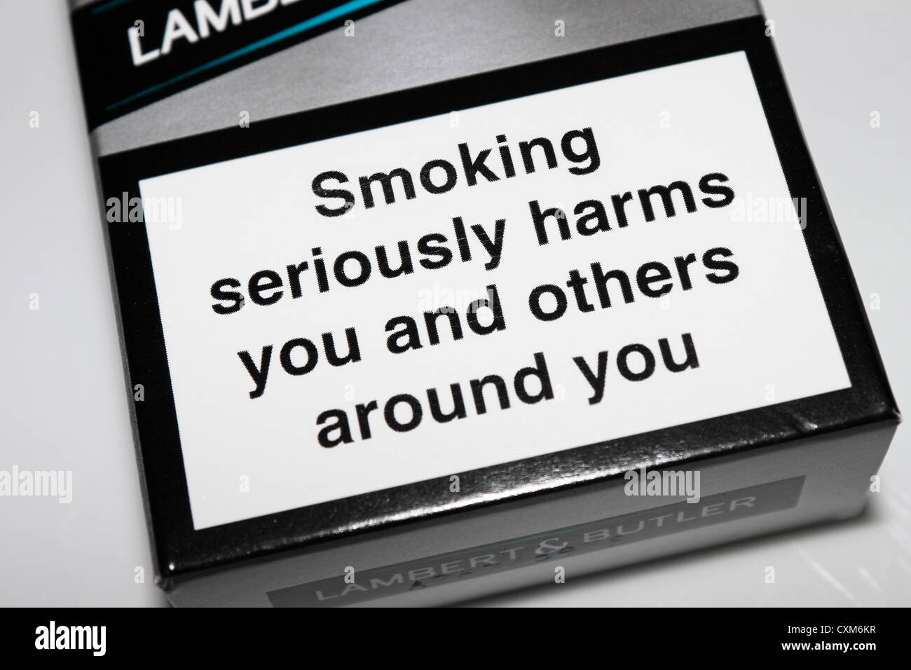 Cigarette packet health warning - Stock Image