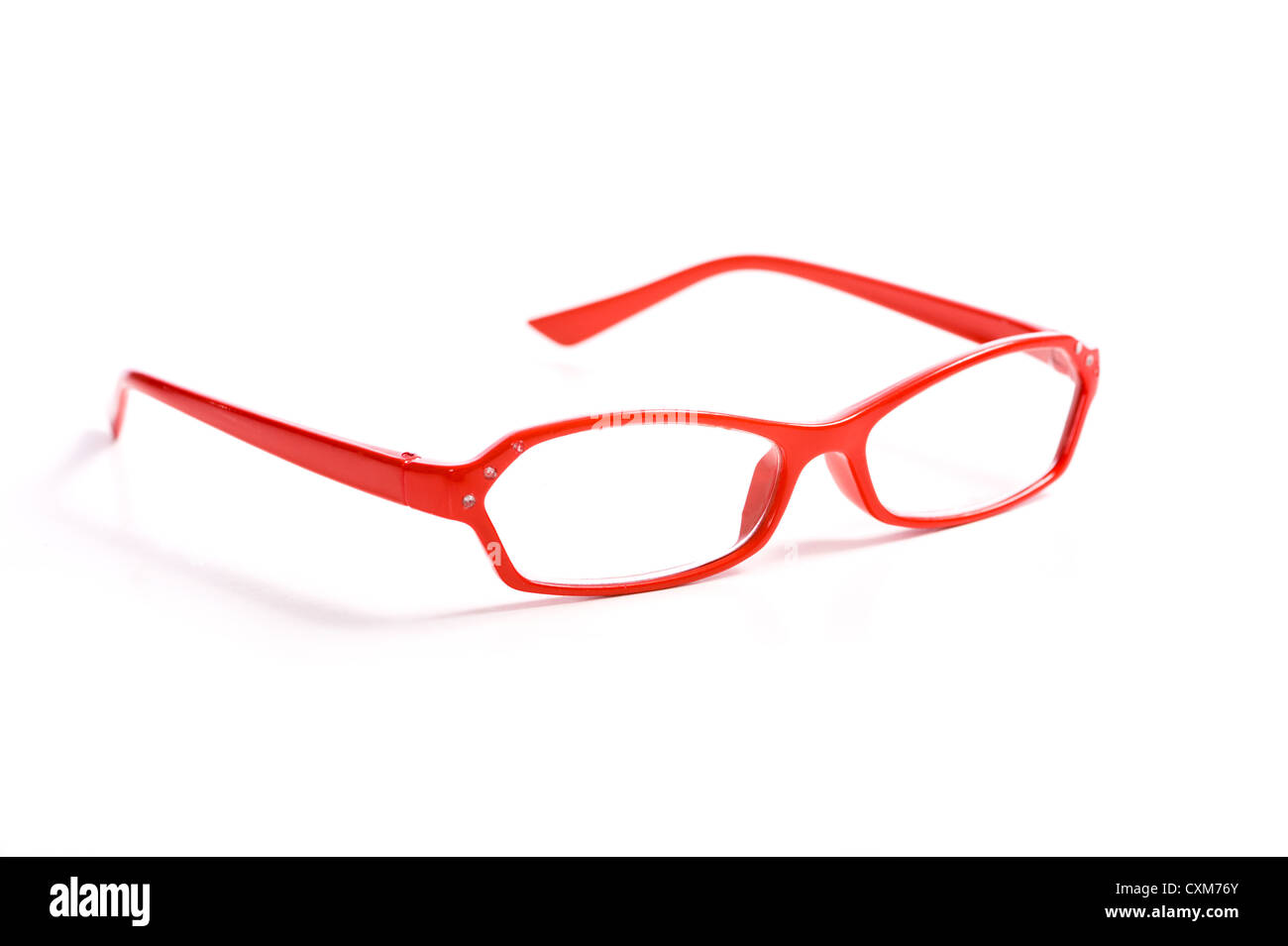 A pair of red reading glasses on white background with copy space - Stock Image
