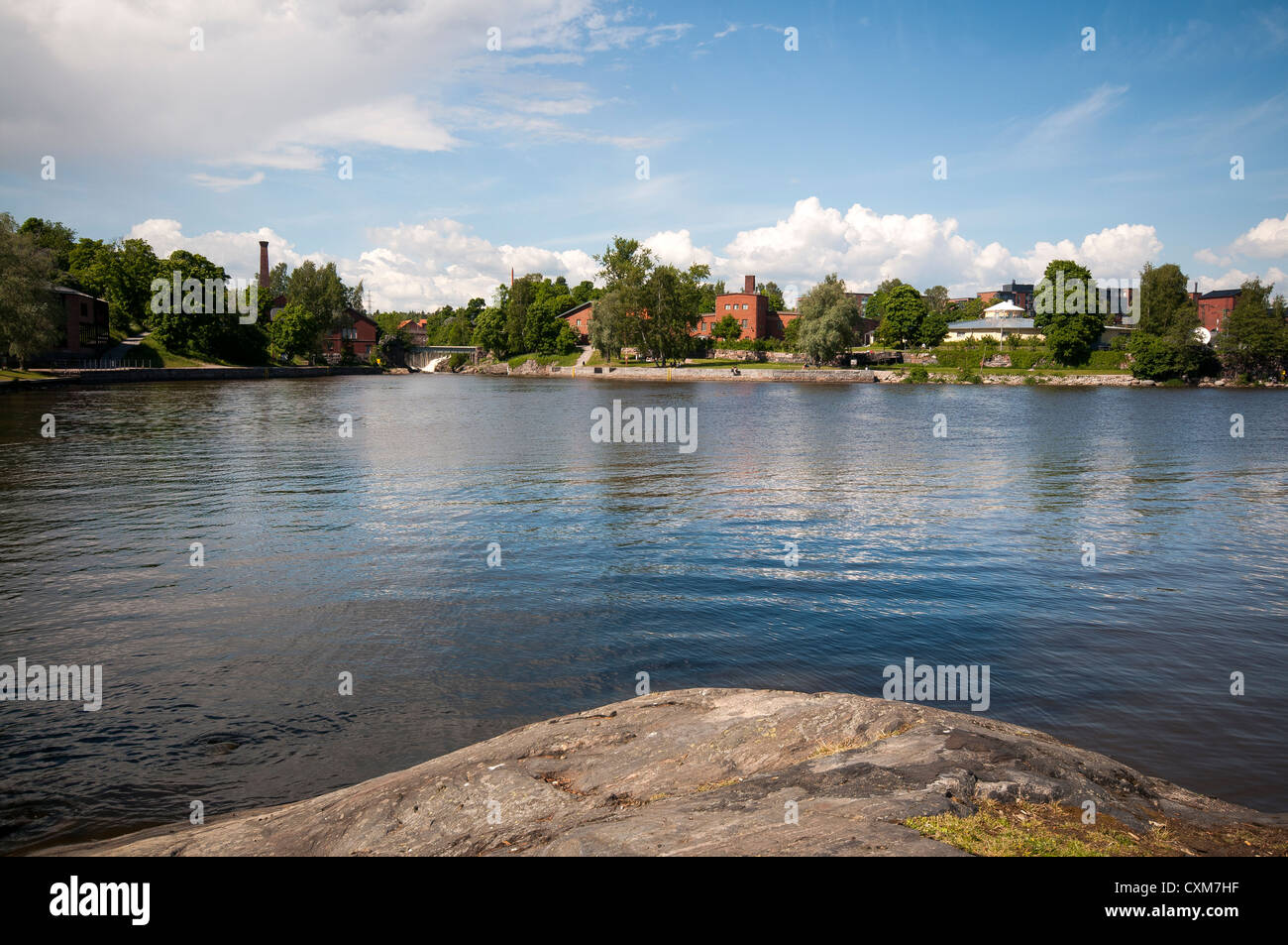 The Vantaa River in 'Old Town' part of Helsinki with the Museum of Technology on the distant shore Stock Photo