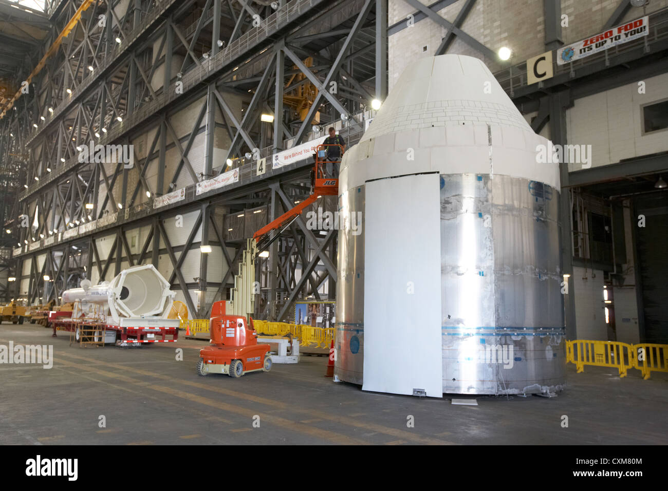 worker works on mockup of the nasa orion command and service modules Kennedy Space Center Florida USA - Stock Image