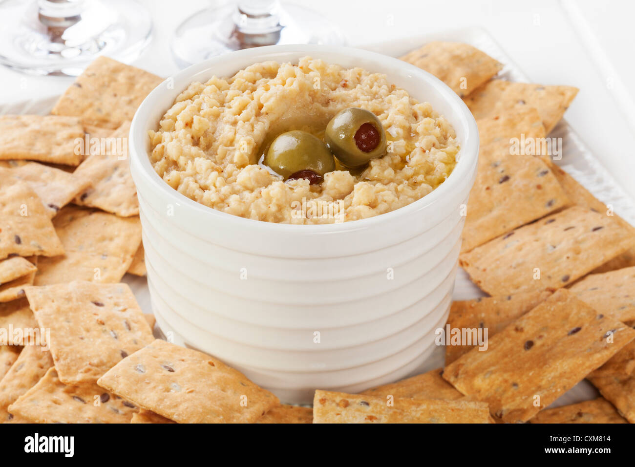 Hummus served with crackers. Low calorie version with less oil. - Stock Image