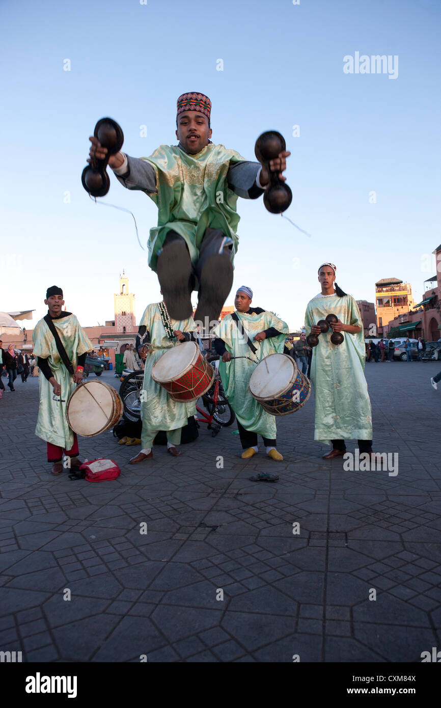 Dancers in traditional costumes in Jamaa el Fna Square in Marrakech, Morocco Stock Photo