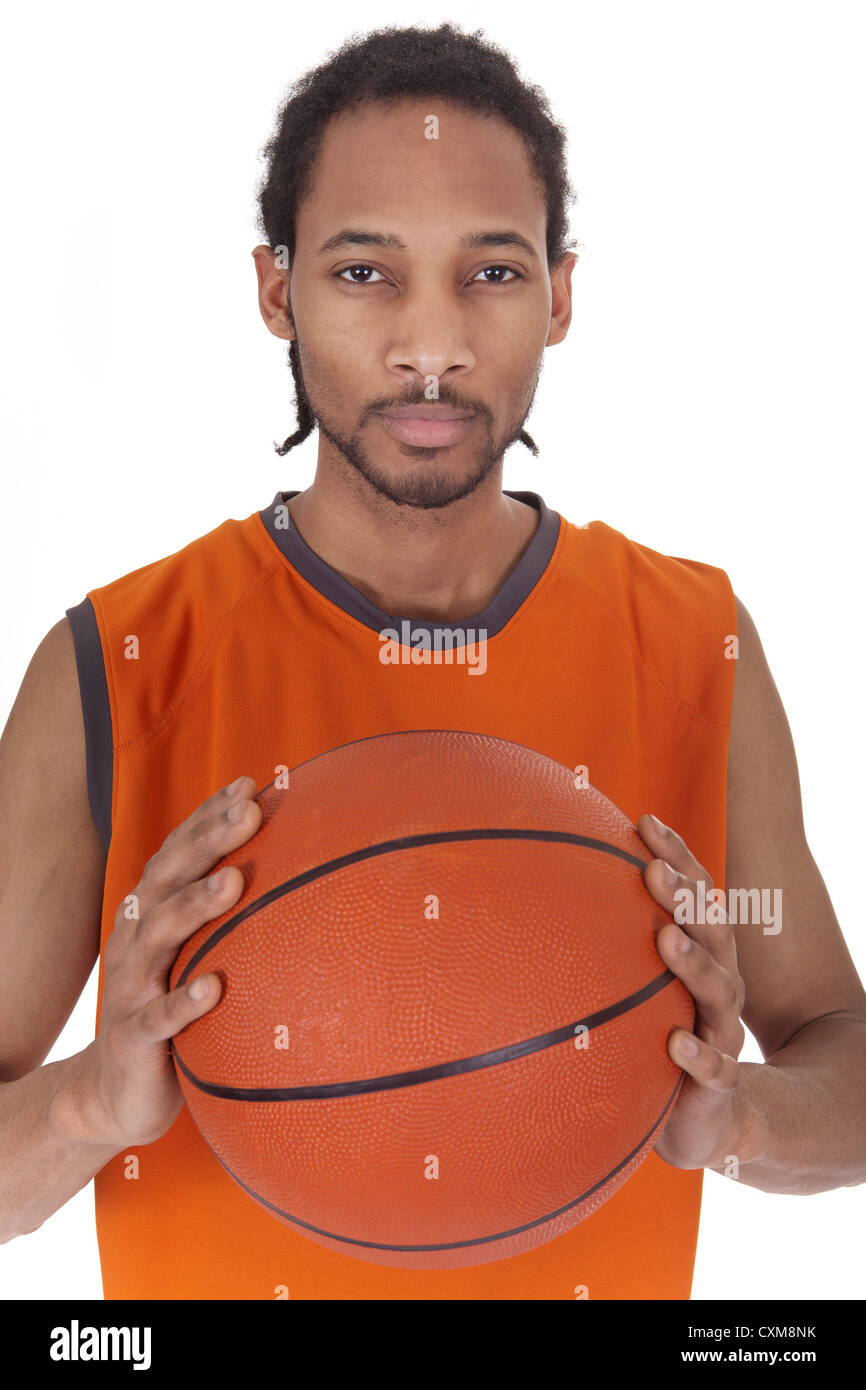 male basketball player holding a ball between two hands - Stock Image