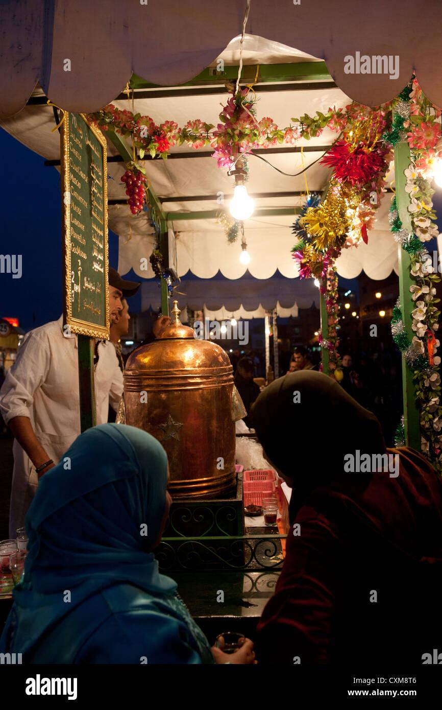 Jamaa el Fna Square in Marrakesh, Morocco Spicy Tea Stand Muslim Woman Women Water Boiler Copper Stock Photo