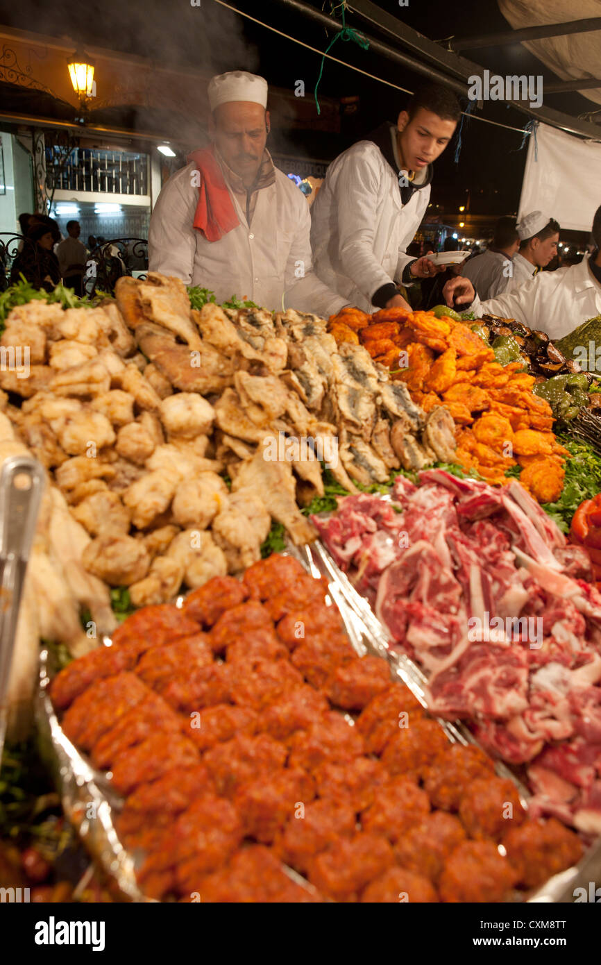 Jamaa el Fna Square in Marrakech, Morocco Local Food Stalls Chicken Marinated Meat Vegetables Grill Grilled Skewers - Stock Image