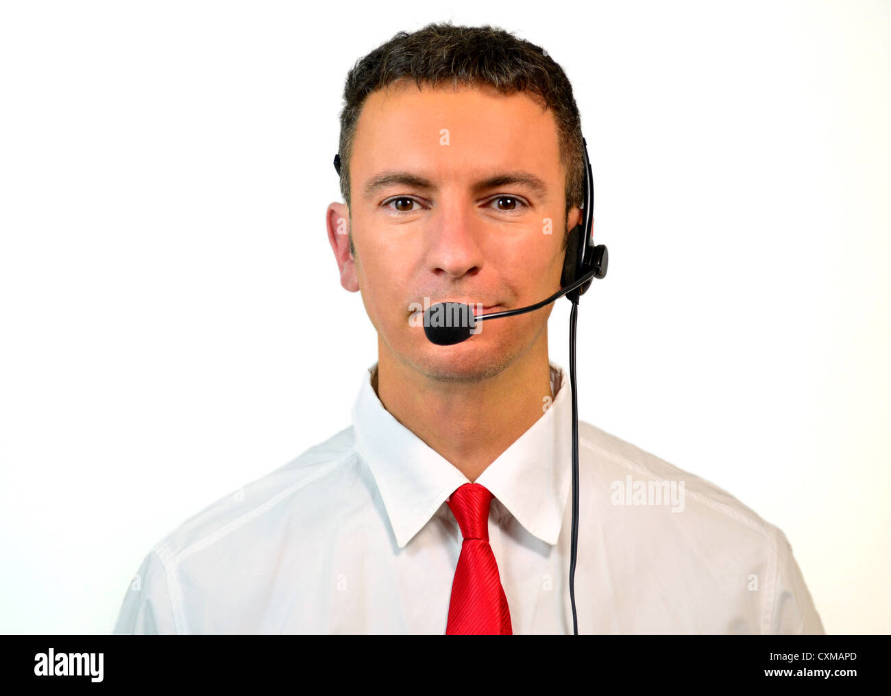 Good looking young man, at sales or support department, with headset Stock Photo