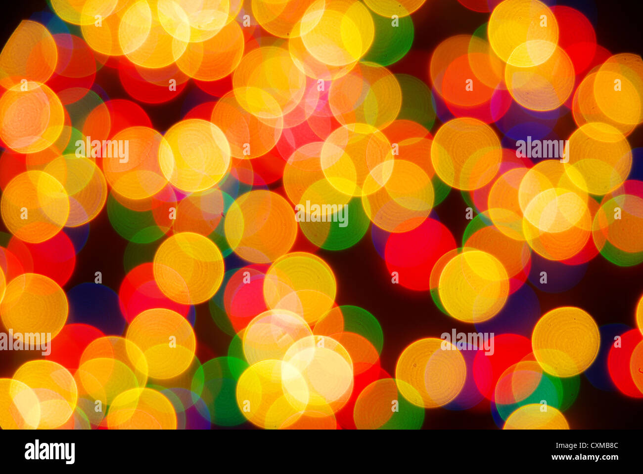 Abstract christmas lights as background on black - Stock Image
