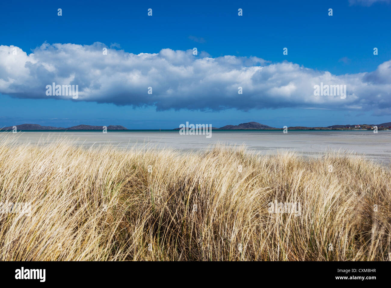 View of Traigh Mhor from behind maram grass covered sand dunes, Barra, Outer Hebrides, Scotland, UK - Stock Image