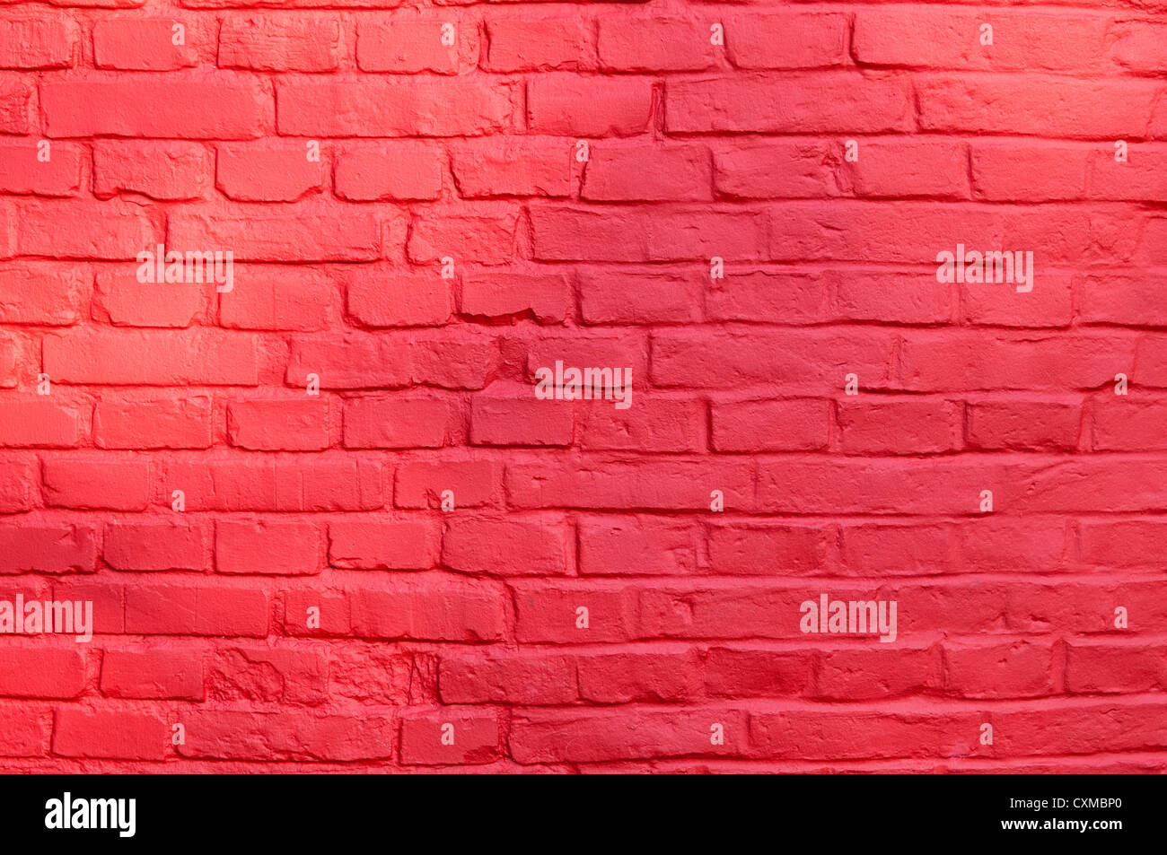 Stone texture - brick wall painted with red color. Stock Photo