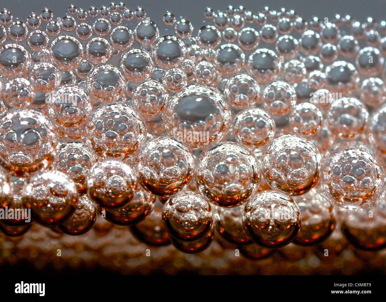 a closeup of cola fizz - Stock Image