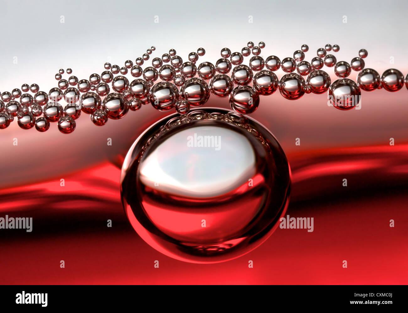 a single bubble followed by smaller bubbles - Stock Image