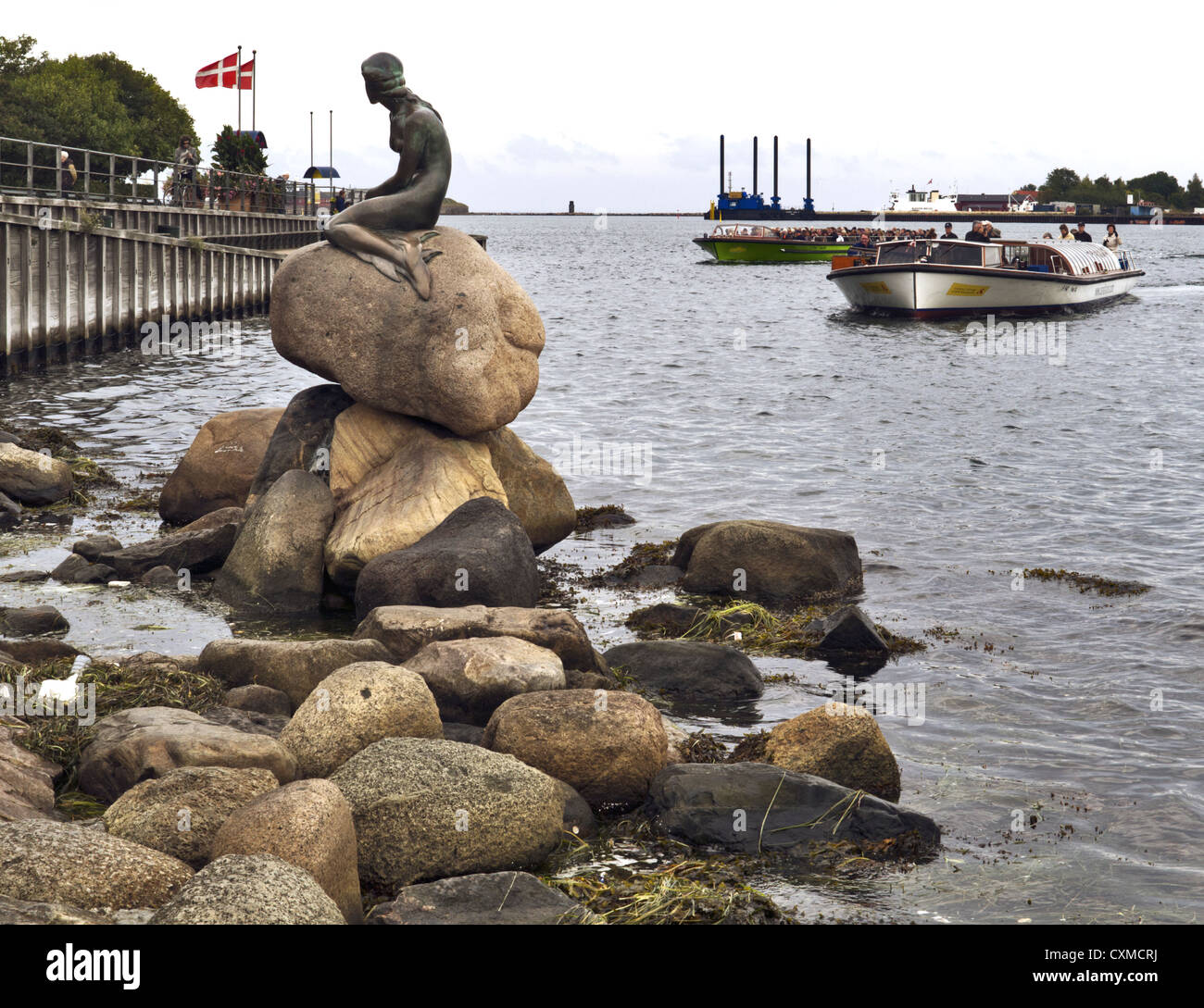 Tourist boats approaching the Little Mermaid, Copenhagen harbour, Denmark Stock Photo
