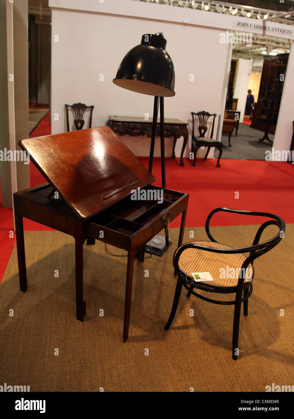 eclectic mix of 21st century and antique furniture at the Irish Antique Dealers 47th Annual Fair, Dublin - Stock Image