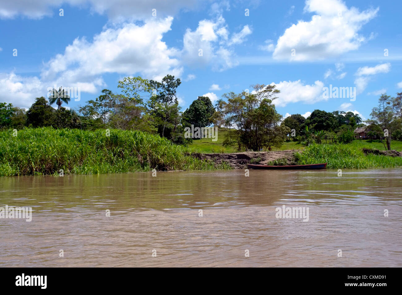 Amazon river margin landscape & Indian community boat pear Stock Photo