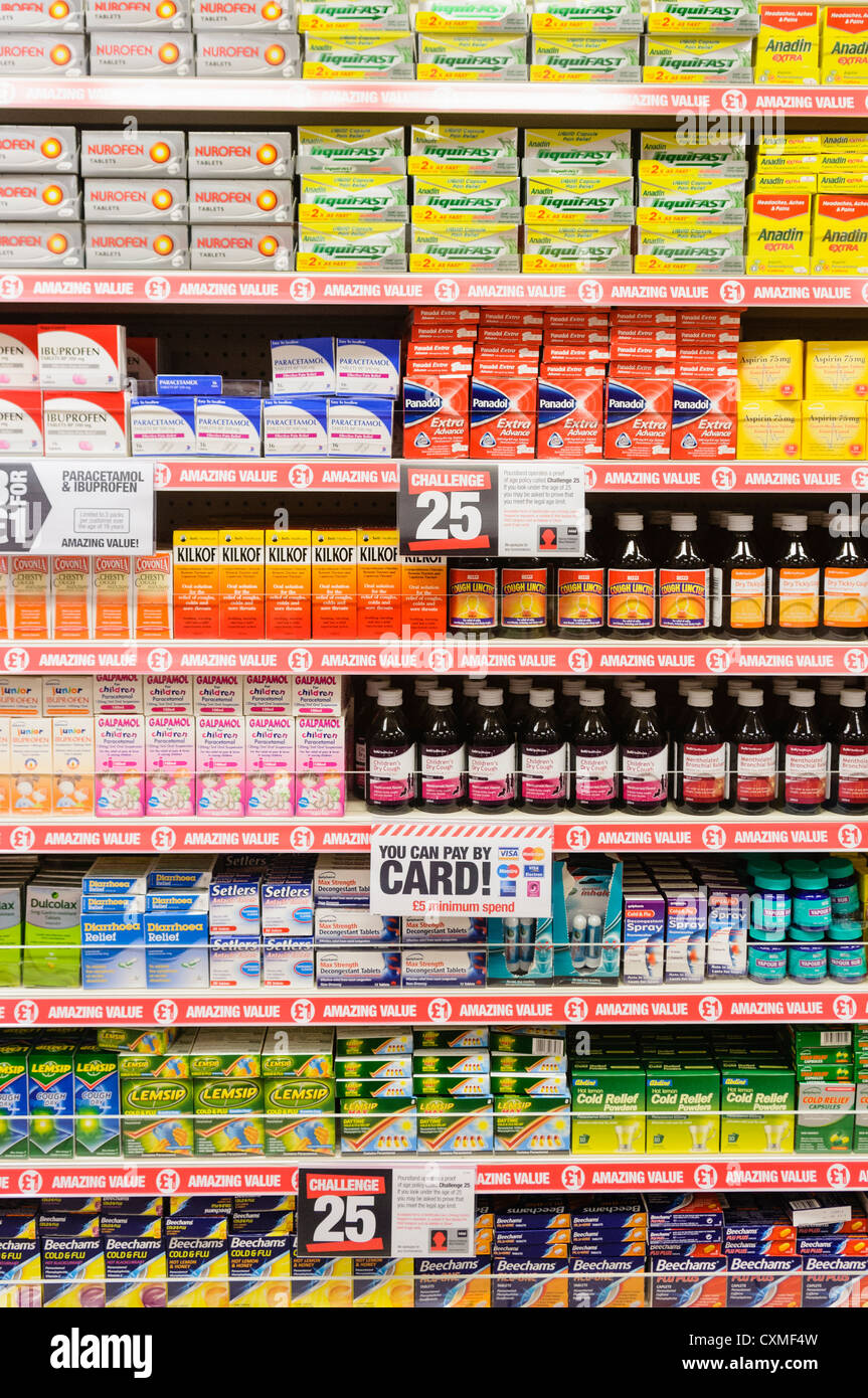 Selection of tablets and medicines on sale on the shelves in a Poundland shop store. - Stock Image