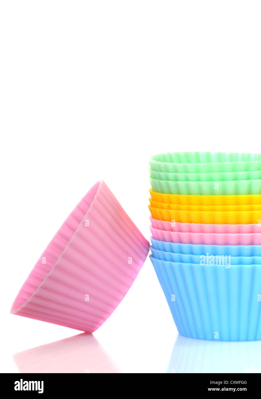 Stack of a variety of colorful cupcake liners - Stock Image