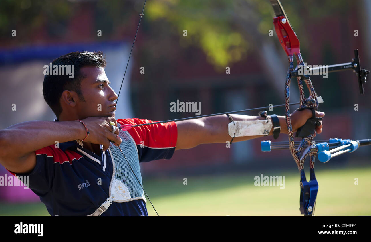 Sportsperson practicing archery - Stock Image