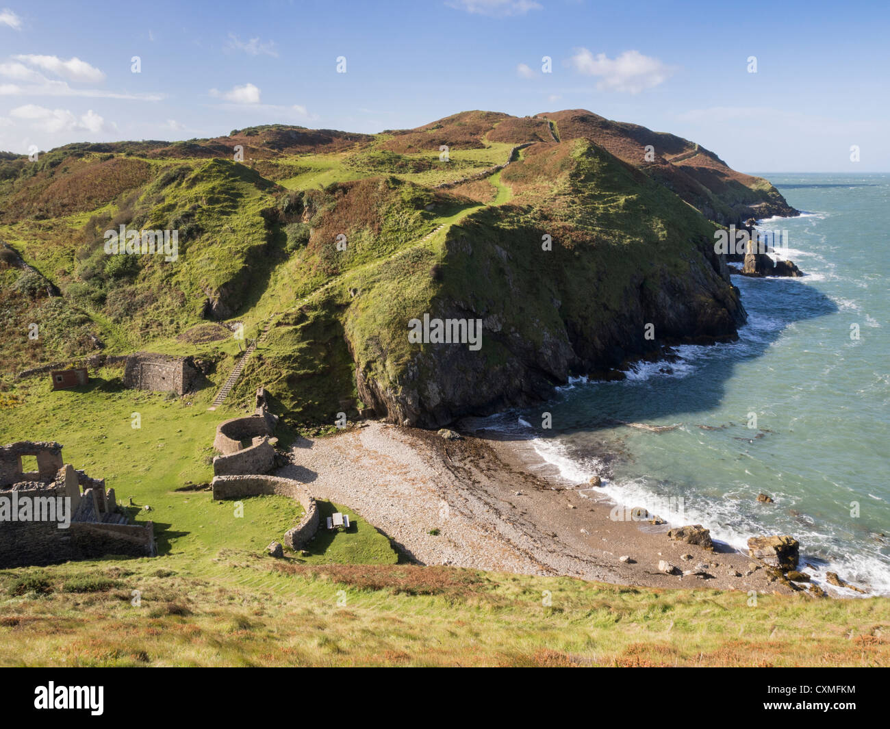 View of Isle of Anglesey Coastal Path and rugged coastline at Porth Llanlleiana Bay Cemaes Anglesey North Wales - Stock Image