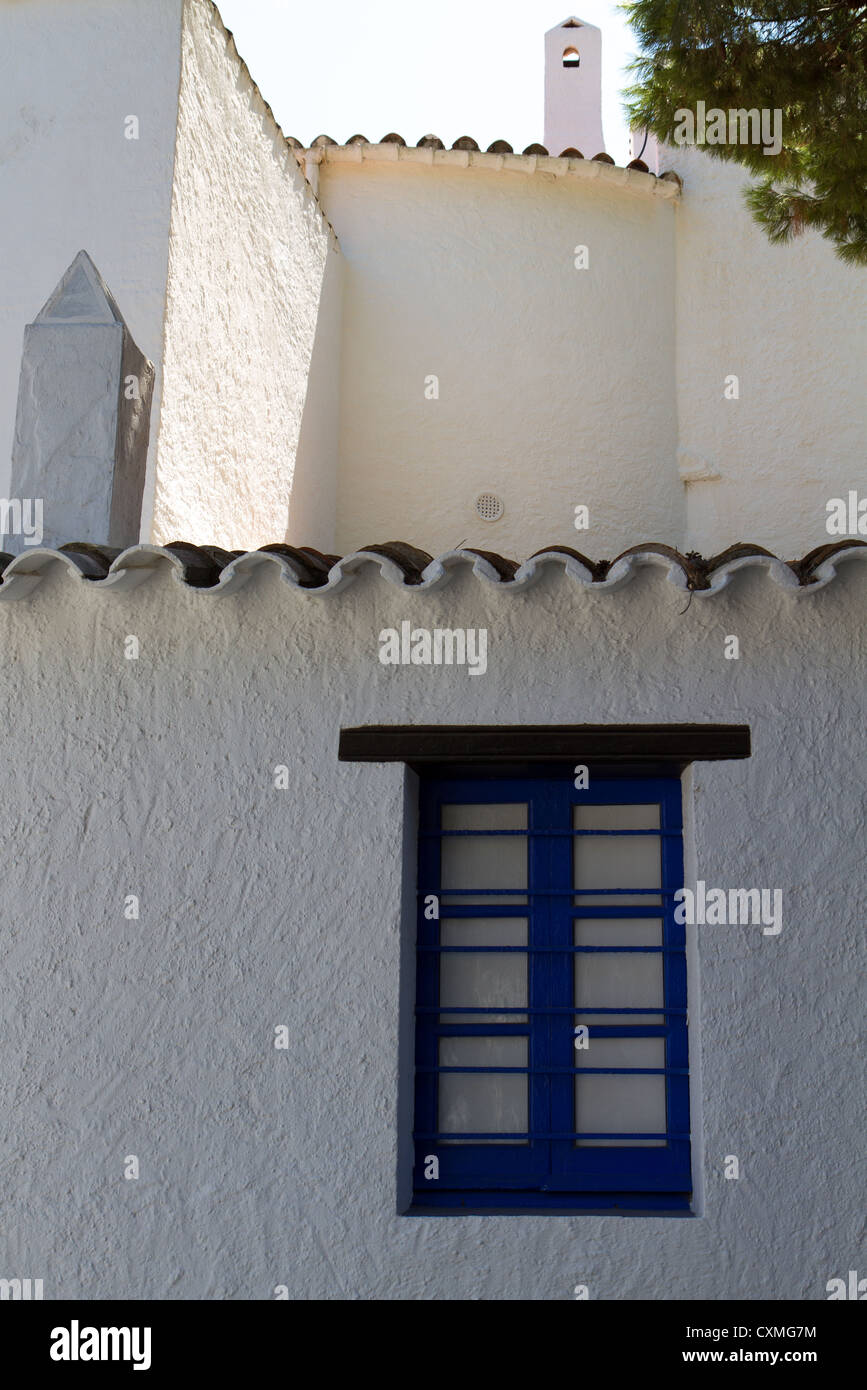 Blue painted window frame in white structured wall Stock Photo ...