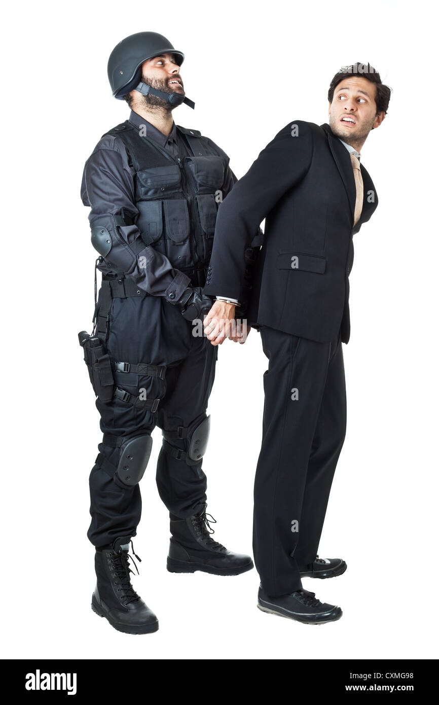 a corrupted businessman being arrested by a swat agent - Stock Image