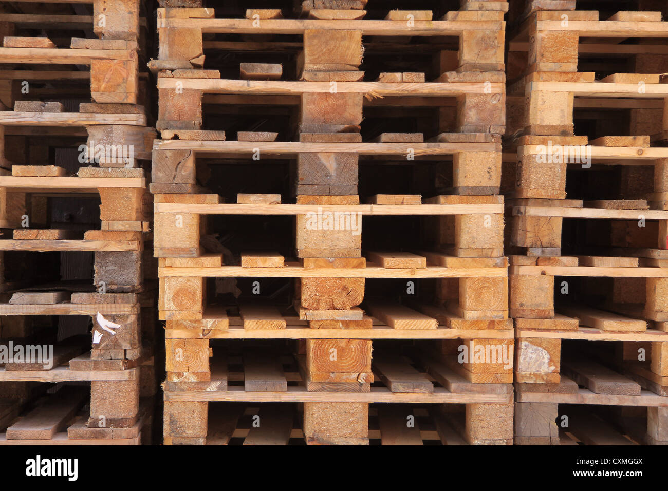 Stacked Euro pallets in longitudinal view - Stock Image