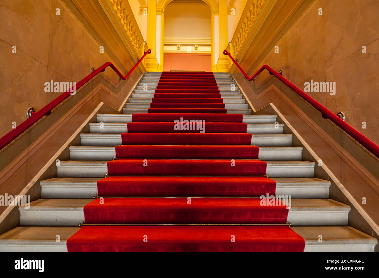 Red carpet lined staircase - Stock Image