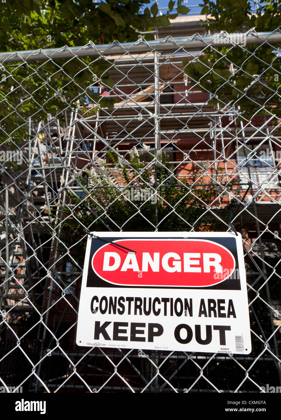 Danger sign on fenced construction area - Stock Image