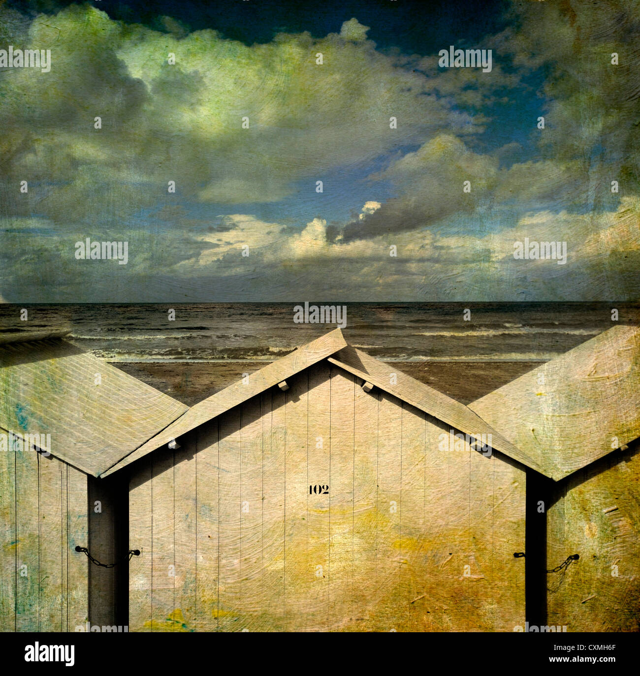 Beach huts under a stormy sky, vintage-look - textured art effect image Stock Photo
