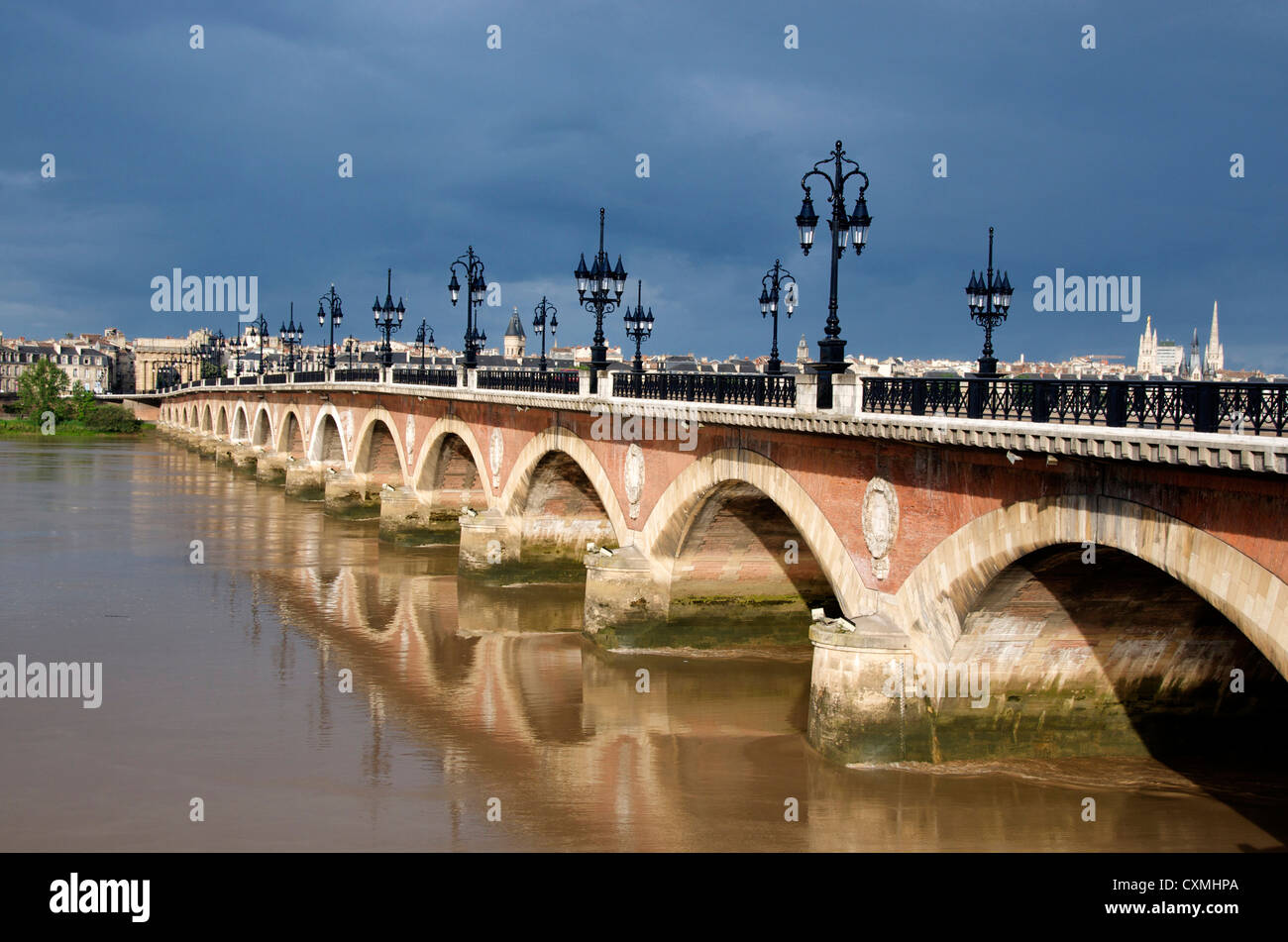 The Pont de Pierre bridge crossing the river Garonne, Bordeaux, France in the city centre - Stock Image