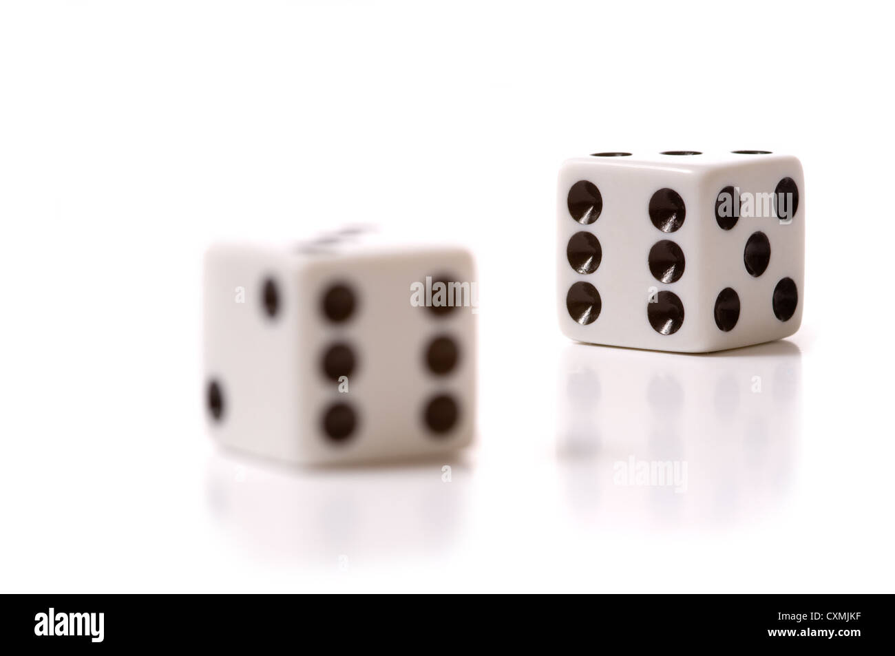 a set of White dice on a white background - Stock Image